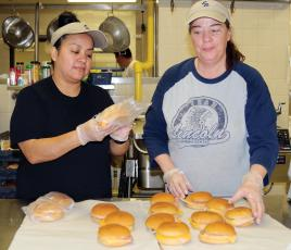 ERPS cafeteria workers Rosas and Bechtel sack up sandwiches