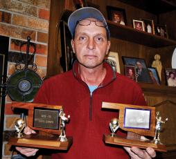 Larry Annuschat shows the trophies that brothers, Ron and Nick brought home in 1979