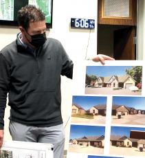 Mark Grubbs shows off the design of the senior housing development