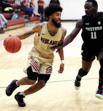 RCC mens basketball_Coppage dribbles past