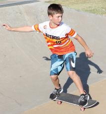 Kal LaFoe rides down a ramp at the city's skate park