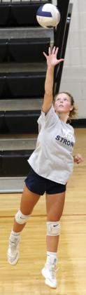 Bailey Denwalt serves during drills