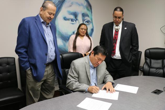 Gov. Reggie Wassana signs documents placing land in Geary into trust