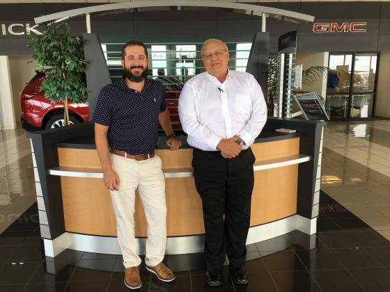 Cole Dorsey, left, and Rick Jones inside the dealership