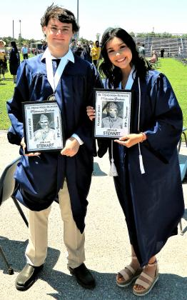 Cash Crawford and Chasity Ramos hold up photos