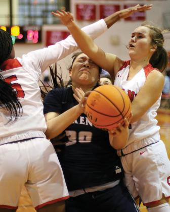 EHS girls basketball_Primeaux takes two elbows across the face