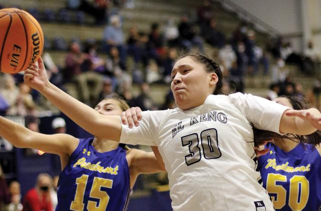 Paige Primeaux has her arm pulled back from a rebound attempt