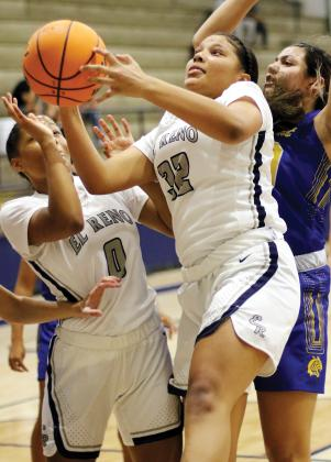 Pauline Black-Harmon pulls down a rebound in front of Janae Black-Harmon