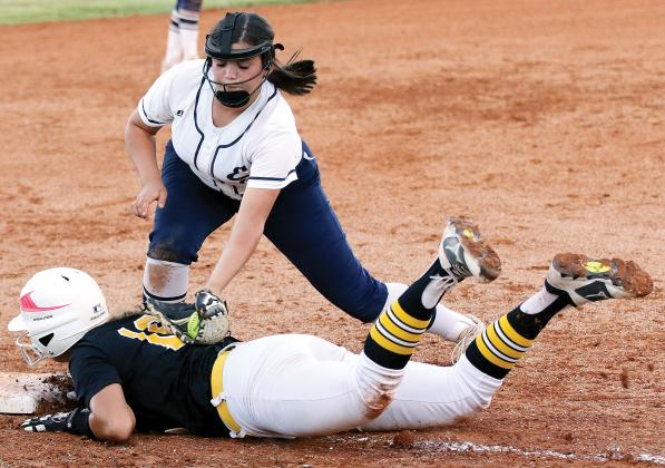 Chenoa White slaps a tag on a Lawton Mac runner