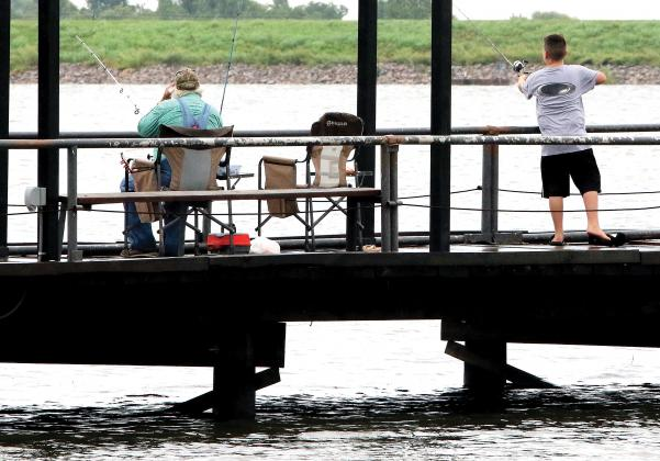 Visitors to Lake El Reno fished off the main west-side pier