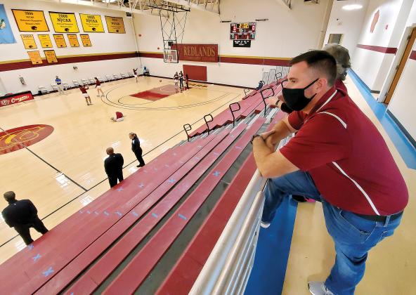 Eli Zucksworth looks out over an empty RCC gymnasium