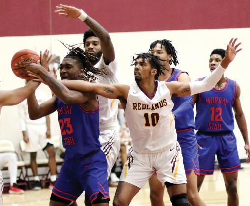 RCC men's basketball_Lyons battles for rebound