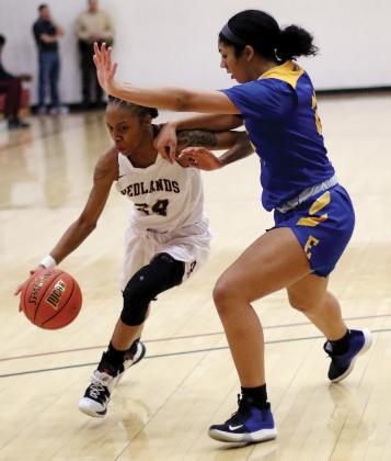 RCC women's basketball_Hopkins drives under block of El Reno native Davis