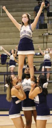 Briana Stevenson gets a boost into the air from teammates