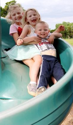 Three kids on slide