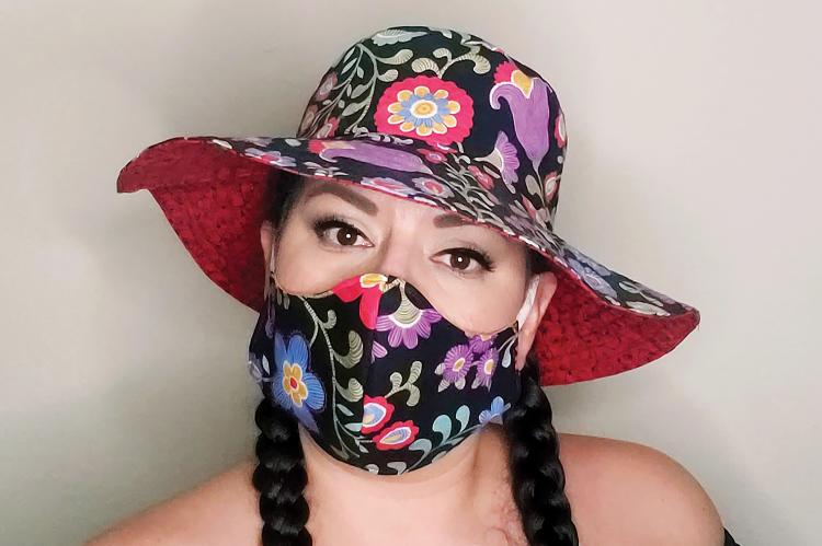 Nan Blassingame models her floral hat and mask combo
