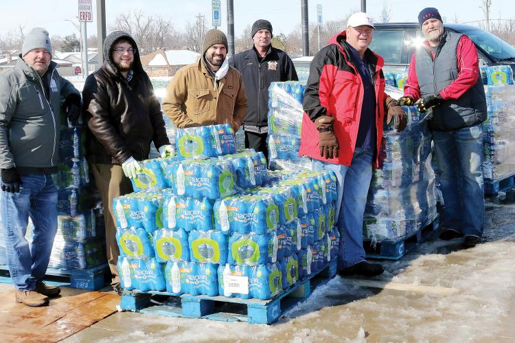 The city of El Reno handed out cases of water to residents