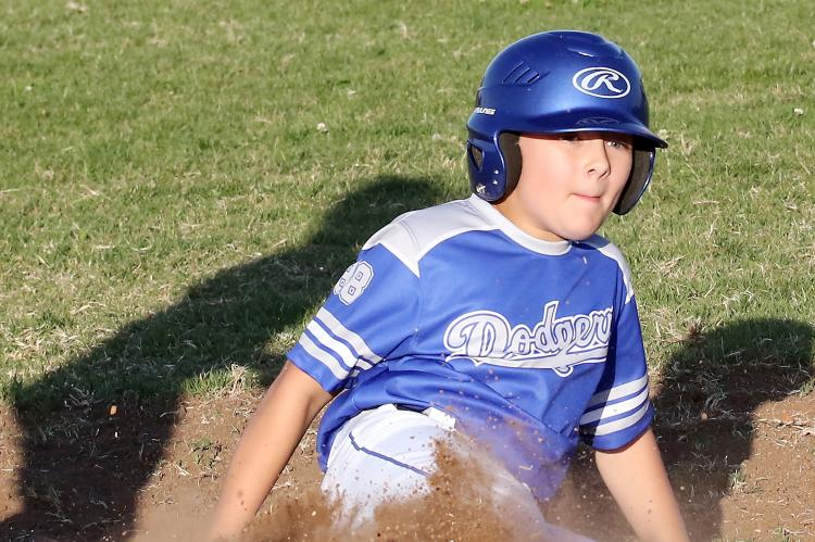 Aden Lanman slides into third base