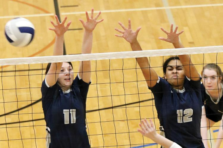 Cassie Avendano and Madison Nichols attempt a block