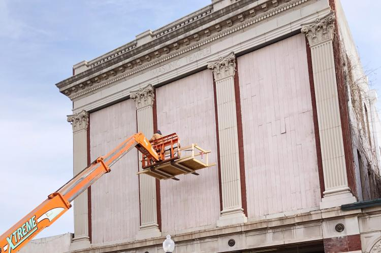 Crews working on the front veneer of the historic Opera House in El Reno