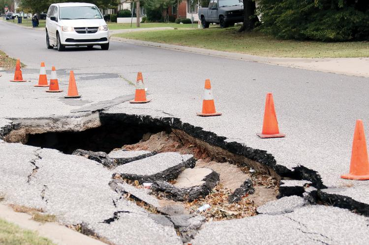 A vehicle approaches the sink hole at Boynton and Shuttee
