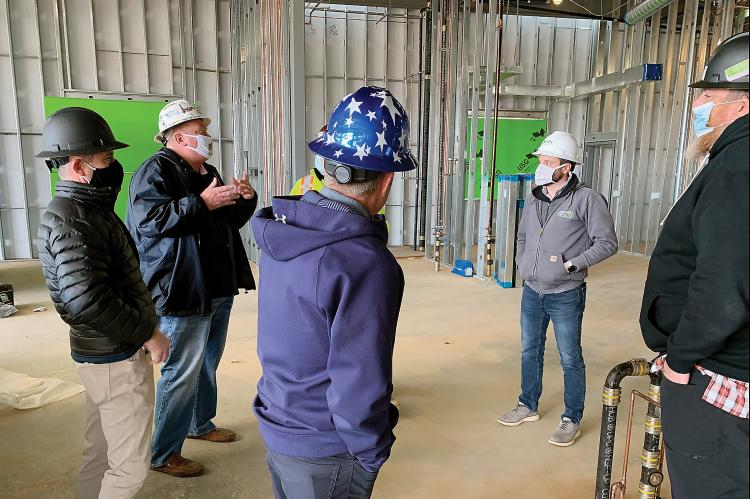 Matt White discusses the progress of the new SSM Health Center during a tour