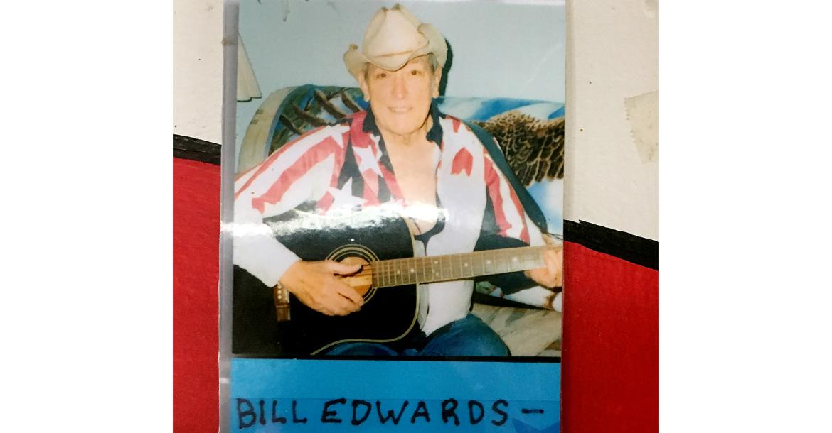 A photo of Bill Edwards is displayed on the walls of Sid's Diner_slideshow