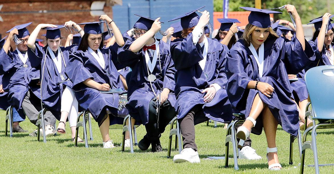 Members of the Class of 2020 switch their hat tassels_slideshow